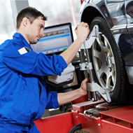 A Man Adjusting Wheel Alignment